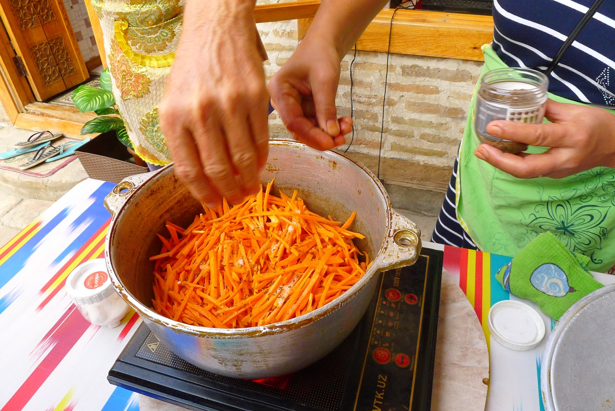 Add in carrots and season with salt and cumin